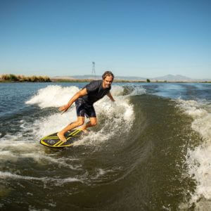 Hyperlite Shim 4.7 Wakesurfer board in action